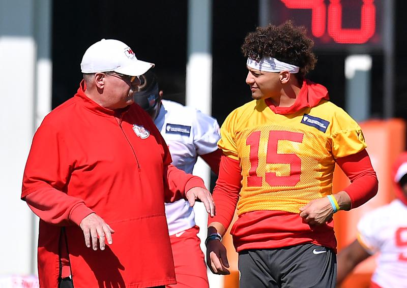 Head coach Andy Reid and quarterback Patrick Mahomes collaborate at practice this week as they plan for Super Bowl LIV against the 49ers. (Photo by Mark Brown/Getty Images)