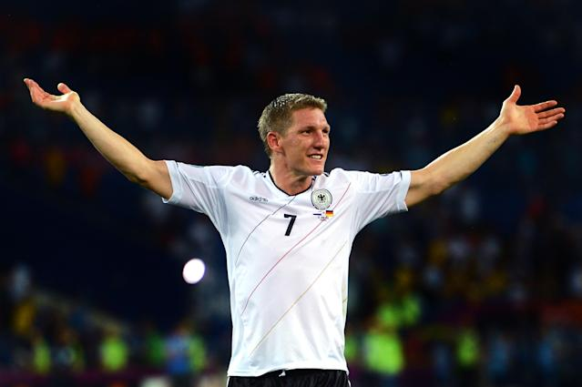 KHARKOV, UKRAINE - JUNE 13: Bastian Schweinsteiger of Germany celebrates victory during the UEFA EURO 2012 group B match between Netherlands and Germany at Metalist Stadium on June 13, 2012 in Kharkov, Ukraine. (Photo by Lars Baron/Getty Images)