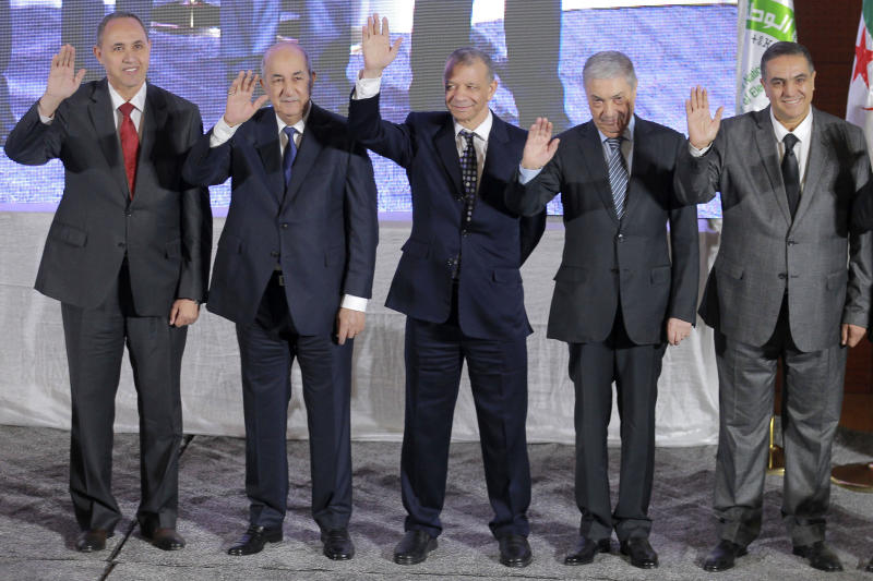 FILE - In this Oct. 17, 2019 file photo, the five candidates for the upcoming Dec. 12, presidential election, from left to right, Azzedine Mihoubi, Abdelmajid Tebboune, Abdelkader Bengrina, Ali Benflis and Abdelaziz Belaid pose prior to a media conference in Algiers. Algeria's powerful army chief promises that a presidential election on Thursday, Dec. 12, 2019 will define the contours of a new era for a nation where the highest office has stood vacant for eight months. The tenacious pro-democracy movement which forced leader Abdelaziz Bouteflika to resign after 20 years in power doesn't trust the confident claim and is boycotting the vote. (AP Photo/Fateh Guidoum, File)