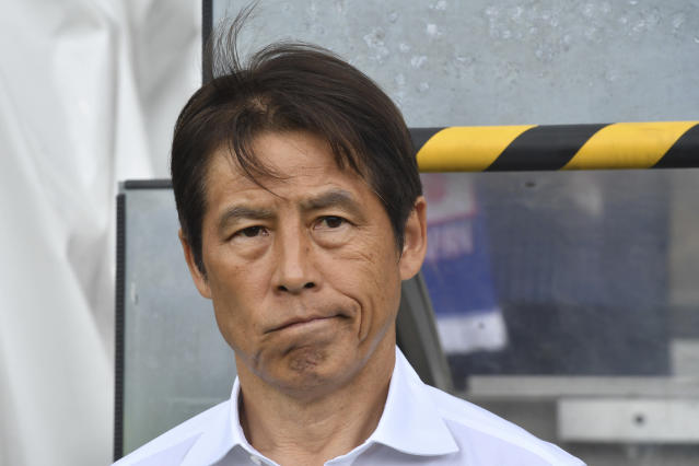 Japan's head coach Akira Nishino looks on prior the friendly soccer match between Japan and Paraguay in the Tivoli Stadium in Innsbruck, Austria, on Tuesday, June 12, 2018. (AP Photo/Kerstin Joensson)