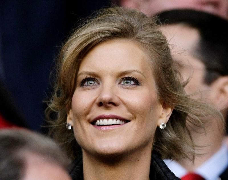 Dubai International Capital's chief negotiator Staveley smiles before the Champions League semi-final match in Liverpool