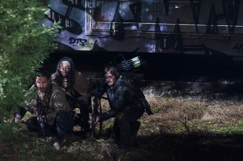 """Rick Grimes (Andrew Lincoln), Michonne (Danai Gurira) and Daryl Dixon (Norman Reedus) in """"The Walking Dead"""" Season 3 Finale, """"Welcome to the Tombs."""""""