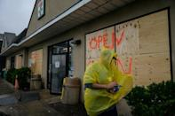 A man walks outside a convenience store as Tropical Storm Henri approaches, in Montauk, Long Island on August 22, 2021