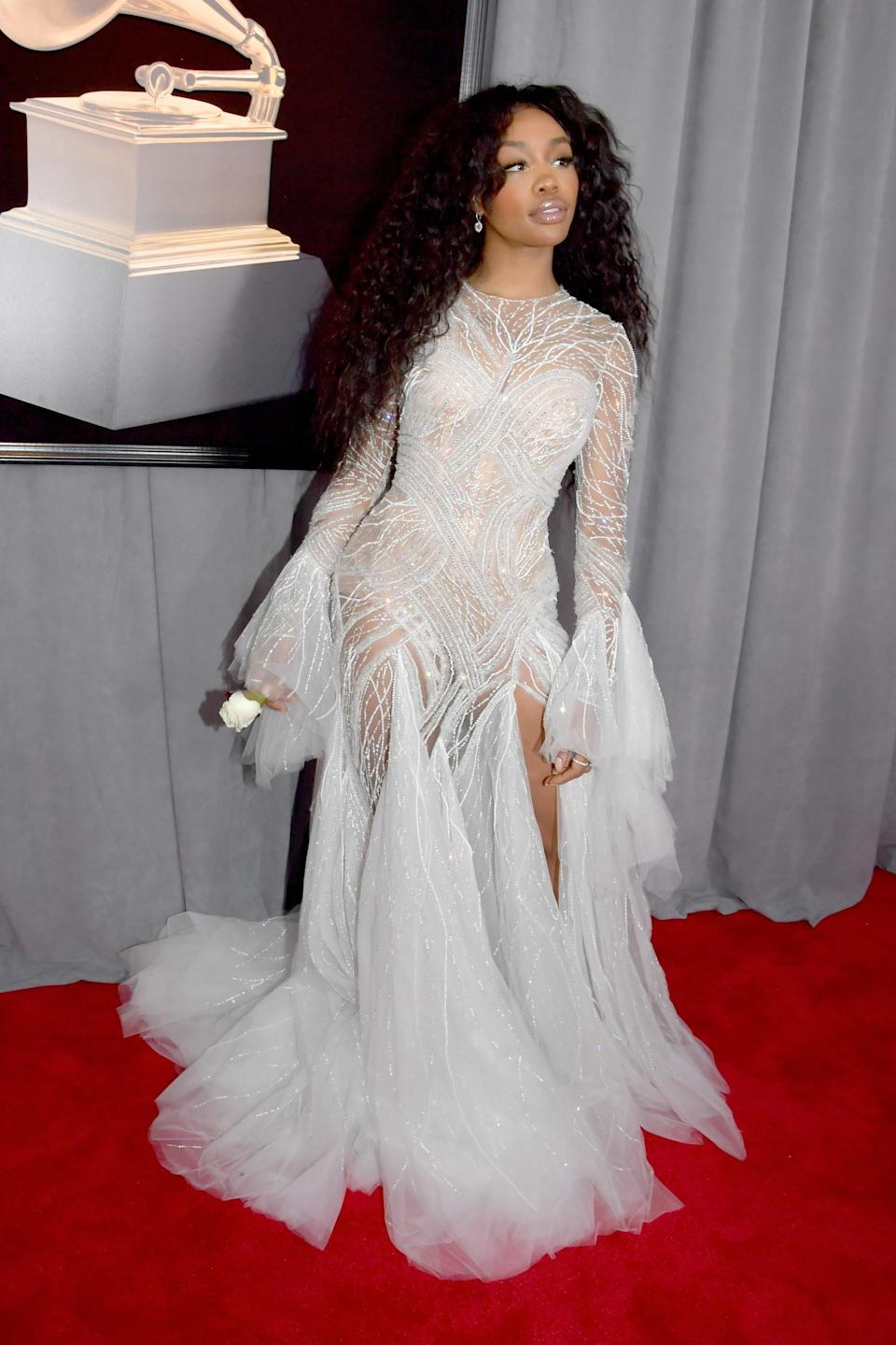 """<h1 class=""""title"""">Sza in Atelier Versace and Chopard jewelry</h1><cite class=""""credit"""">Photo: Getty Images</cite>"""