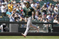 Oakland Athletics' Matt Olson rounds the bases after he hit a solo home run during the third inning of a baseball game against the Seattle Mariners, Sunday, July 25, 2021, in Seattle. (AP Photo/Ted S. Warren)