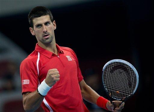 Serbia's Novak Djokovic reacts after winning a set point against Florian Mayer during their men's singles semifinal match in the China Open tennis tournament in Beijing Saturday, Oct. 6, 2012. Djokovic defeated Mayer 6-1, 6-4. (AP Photo/Andy Wong)