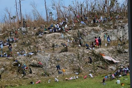 Displaced Haitian nationals take refuge on the grounds of the Government complex in the aftermath of Hurricane Dorian in Marsh Harbour