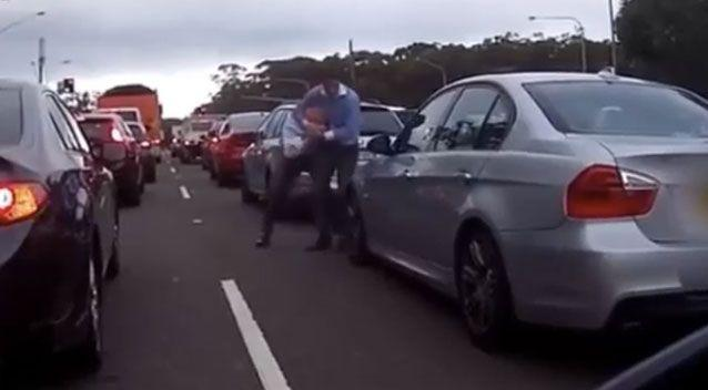 One of the men unleashed a tight squeezing headlock on the other. Source: Facebook/ DashCam Owners Australia