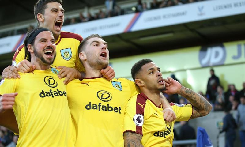 Andre Gray and Burnley celebrate their second goal.