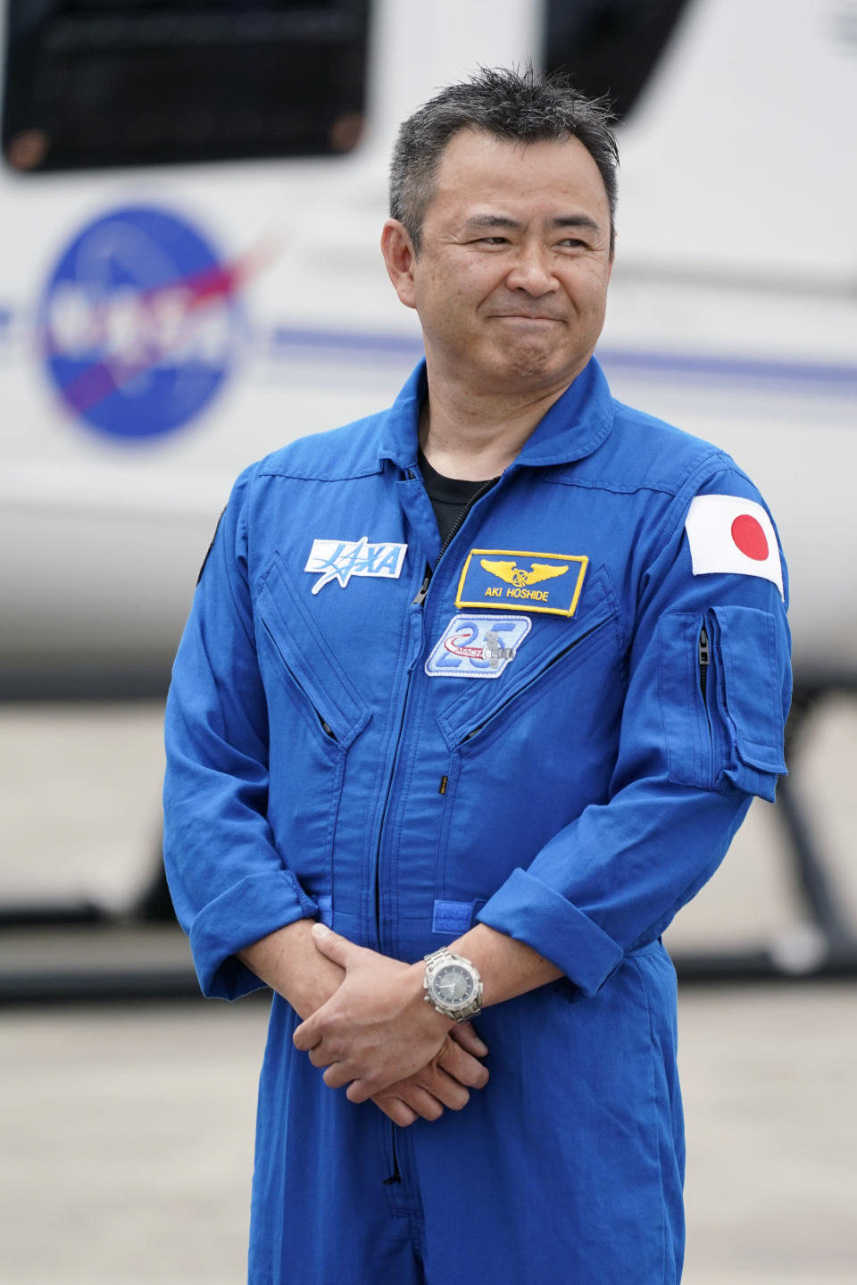 SpaceX Crew 2 member, Japan Aerospace Exploration Agency astronaut Akihiko Hoshide smiles as he arrives at the Kennedy Space Center in Cape Canaveral, Fla., Friday, April 16, 2021. The launch to the International Space Station is targeted for April 22. (AP Photo/John Raoux)