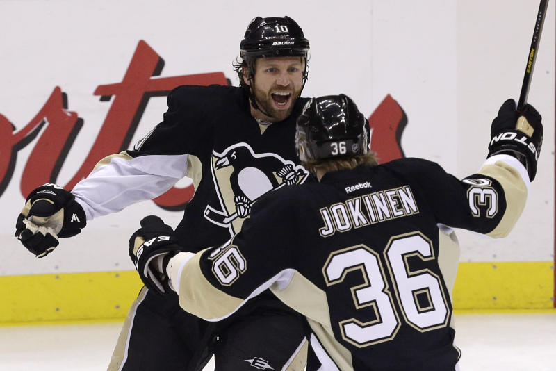 Pittsburgh Penguins' Brenden Morrow (10) celebrates his first-period goal with teammate Jussi Jokinen (36) in Game 5 of the Eastern Conference semifinals in their NHL hockey Stanley Cup playoffs series, Friday, May 24, 2013, in Pittsburgh. (AP Photo/Gene J. Puskar)