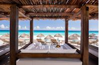 """<p><a href=""""https://go.redirectingat.com?id=74968X1596630&url=https%3A%2F%2Fwww.tripadvisor.com%2FHotel_Review-g150807-d209428-Reviews-JW_Marriott_Cancun_Resort_Spa-Cancun_Yucatan_Peninsula.html&sref=https%3A%2F%2Fwww.bestproducts.com%2Flifestyle%2Fg34125319%2Fwork-from-home-friendly-hotels%2F"""" rel=""""nofollow noopener"""" target=""""_blank"""" data-ylk=""""slk:JW Marriott Cancun Resort & Spa"""" class=""""link rapid-noclick-resp"""">JW Marriott Cancun Resort & Spa</a> in Cancun is making sure the work gets done before the fun. They've designated some of their VIP Bali-style daybeds as """"work stations"""" so guests can work while also enjoying the warm weather. The property has also made what they call """"brain-boosting baskets"""", which include energizing juice, poké mix salad, cold coffee, almond-flour crepes, and more. After a long day in the """"office,"""" enjoy a Mayan-inspired massage or a nice cocktail for happy hour. </p>"""