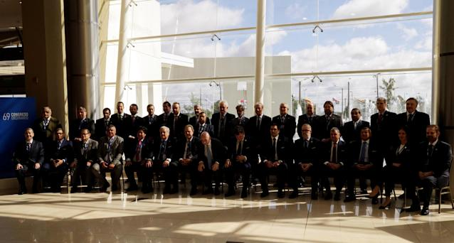 President members and delegates of the participating countries pose the official photo at the 69th CONMEBOL Ordinary Congress at their headquarters in Luque, Paraguay May 11, 2018. REUTERS/Jorge Adorno
