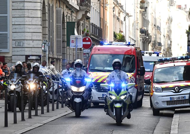 Police officers at the scene in Lyon