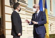 In this photo provided by the Ukrainian Presidential Press Office, Ukrainian President Volodymyr Zelenskiy, left, and European Council President Charles Michel talk as they meet in Kyiv, Ukraine, Wednesday, March 3, 2021. (Ukrainian Presidential Press Office via AP)