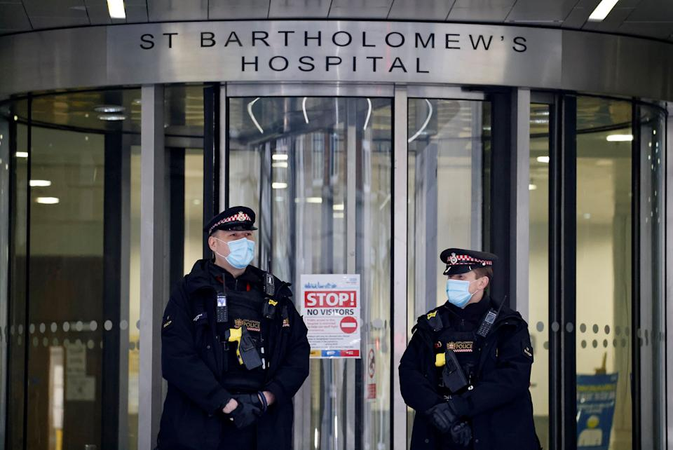Police officers stand on duty outside St Bartholomew's Hospital, commonly known as St Barts, in central London on March 4, 2021 where Britain's Prince Philip, Duke of Edinburgh was transferred to on March 1.