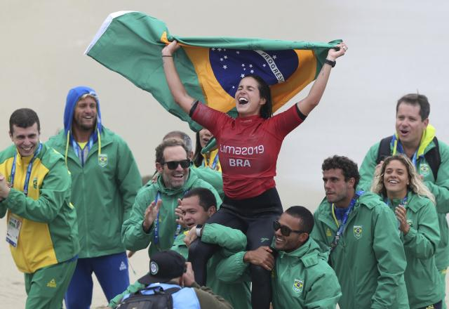 Chloe Calmon of Brazil celebrates wining the gold for longboard during women's SUP surfing events at the Pan American Games on Punta Rocas beach in Lima Peru, Sunday, Aug. 4, 2019. (AP Photo/Martin Mejia)
