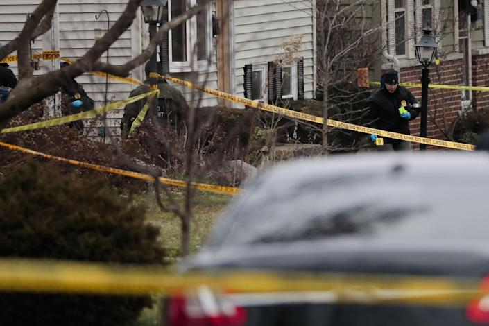 Agents from the Ohio Bureau of Criminal Investigation work the scene of a fatal shooting in Tuesday.