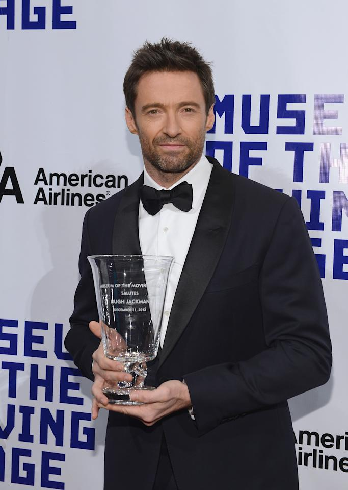 NEW YORK, NY - DECEMBER 11:  Actor Hugh Jackman poses with his award at the Museum of Moving Images salute to Hugh Jackman at Cipriani Wall Street on December 11, 2012 in New York City.  (Photo by Larry Busacca/Getty Images)