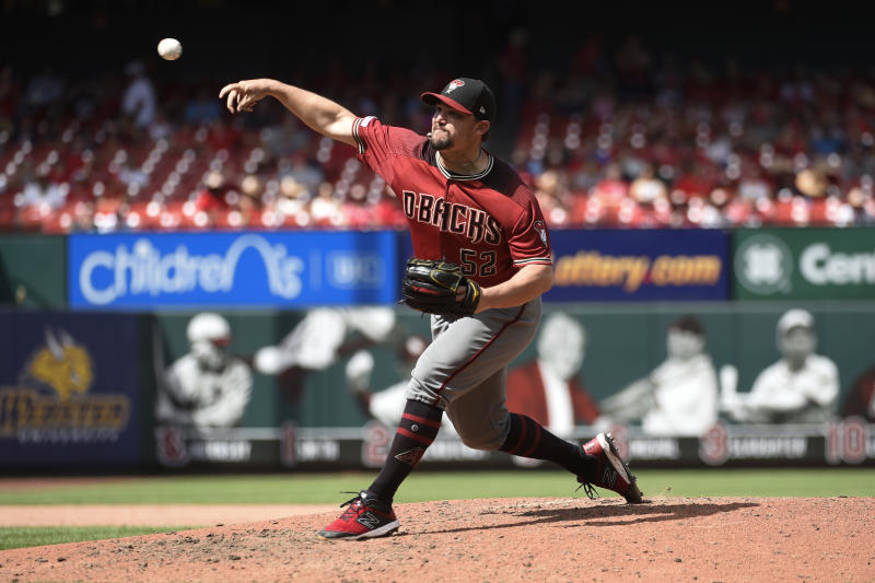 Jul 14, 2019; St. Louis, MO, USA; Arizona Diamondbacks starting pitcher Zack Godley (52) pitches against the St. Louis Cardinals during the eighth inning at Busch Stadium. Mandatory Credit: Joe Puetz-USA TODAY Sports
