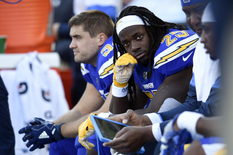 Los Angeles Chargers running back Melvin Gordon looks on from the sideline during the second half of an NFL football game against the Minnesota Vikings, Sunday, Dec. 15, 2019, in Carson, Calif. (AP Photo/Kelvin Kuo)