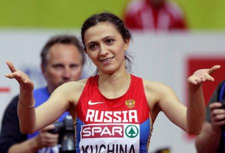 FILE PHOTO: Mariya Kuchina of Russia reacts after winning the women's high jump event during the IAAF European Indoor Championships in Prague March 7, 2015. REUTERS/David W Cerny/File Photo