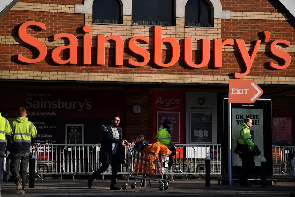 A shopper leaves a Sainsbury's supermarket in Tunbridge Wells on January 7, 2021. - Sainsburys has upgraded its profit expectations by £60m after surging sales of champagne, steaks and other luxury food drove stronger than expected sales over Christmas and new year. (Photo by Ben STANSALL / AFP) (Photo by BEN STANSALL/AFP via Getty Images)