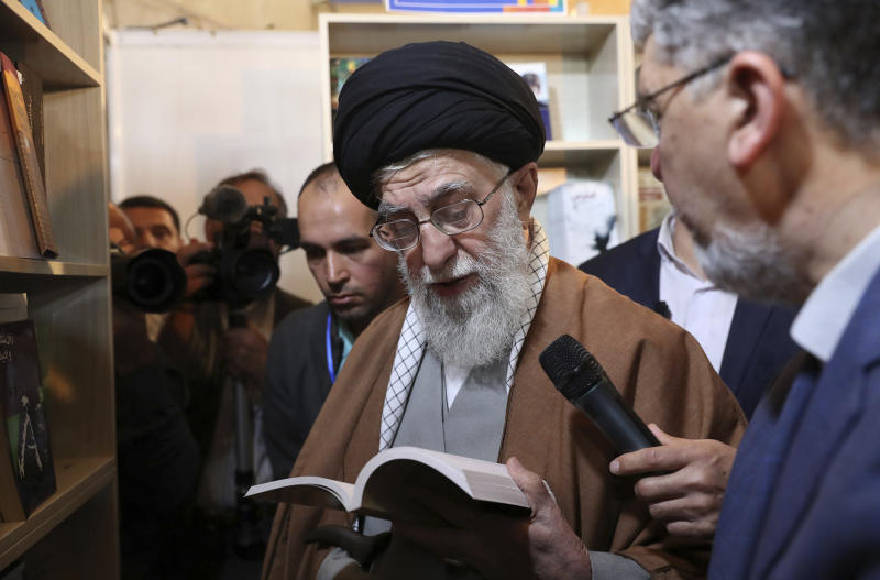 In this picture released on April 29, 2019, by the official website of the office of the Iranian supreme leader, Supreme Leader Ayatollah Ali Khamenei reads part of a book while visiting Tehran's book fair in Tehran, Iran. President Donald Trump signed an executive order on Monday, June 24, 2019, targeting Iran's supreme leader and his associates with financial sanctions, the latest action the U.S. has taken to discourage Tehran from developing nuclear weapons and supporting militant groups. (Office of the Iranian Supreme Leader via AP)