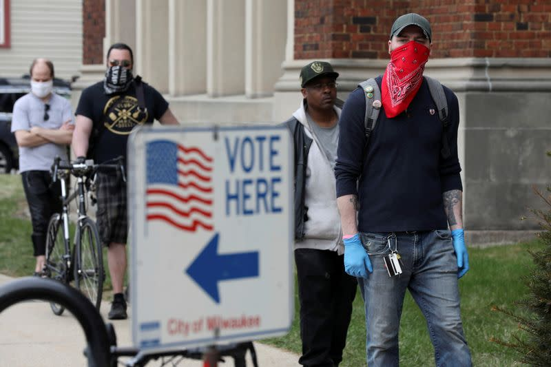 Voters wait to cast ballots during the presidential primary election in Wisconsin