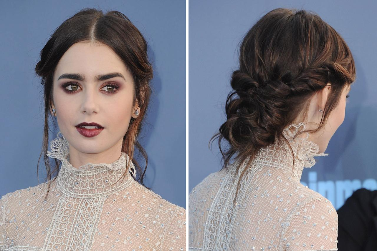 """<p>Hairstylist <a rel=""""nofollow"""" href=""""https://www.instagram.com/gregoryrussellhair?hl=en&mbid=synd_yahooentertainment"""">Gregory Russell</a> created an updo with tons of twists and turns that perfectly complemented Lily's goth-glam Critics' Choice Awards look. This is definitely not your average bun!</p>"""