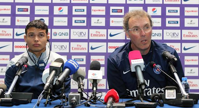 Laurent Blanc (right) and Thiago Silva give a press conference in Doha on January 1, 2014 ahead of a friendly game (AFP Photo/Karim Jaafar)