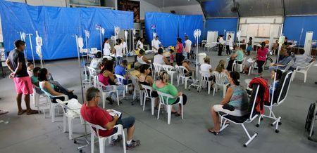 Patients are administered drips as they await the results of their dengue examination, in a medical tent in Rio Claro, Brazil March 5, 2015. REUTERS/Paulo Whitaker