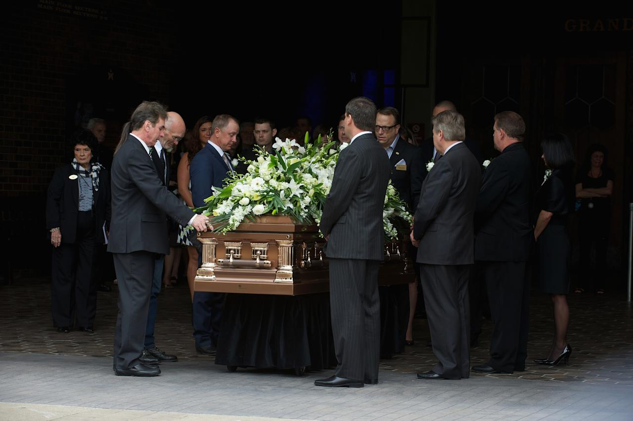 NASHVILLE, TN - MAY 02:  Pallbearers prepare to load the casket at the funeral service for George Jones at The Grand Ole Opry on May 2, 2013 in Nashville, Tennessee. Jones passed away on April 26, 2013 at the age of 81.  (Photo by Jason Davis/Getty Images)