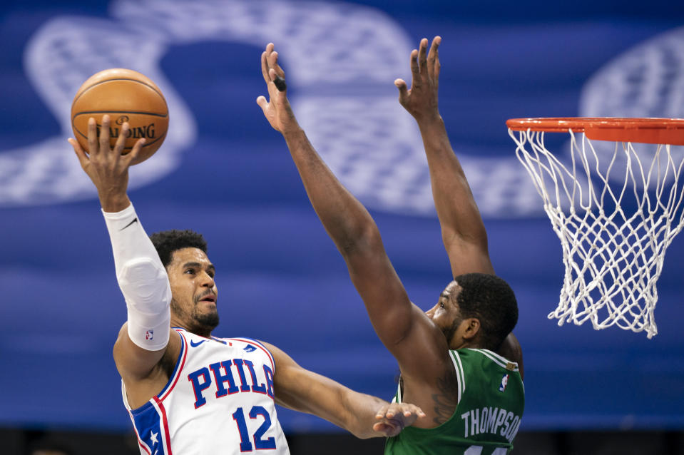 Philadelphia 76ers forward Tobias Harris, left, goes up for a shot against Boston Celtics forward Tristan Thompson during the first half of an NBA basketball game Wednesday, Jan. 20, 2021, in Philadelphia. (AP Photo/Chris Szagola)
