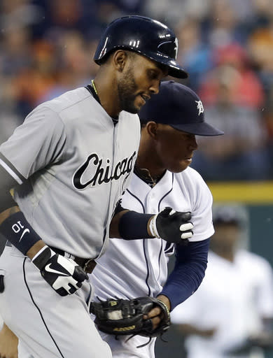 Detroit Tigers second baseman Ramon Santiago, right, tags out Chicago White Sox's Alexei Ramirez in a rundown while Ramirez was attempting to steal second base in the first inning of a baseball game in Detroit, Friday, Sept. 20, 2013. (AP Photo/Paul Sancya)
