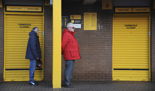 FILE - In this file photo dated Saturday, Feb. 18, 2017, Wolverhampton Wanderers fans wait for turnstiles to open before the English FA Cup Fifth Round soccer match against Chelsea, at Molineux stadium in Wolverhampton, England. Wolves is a team from an industrial city in central England, and are back in the English Premier League for the 2018 season after a six-year absence.(AP Photo/Rui Vieira, FILE)