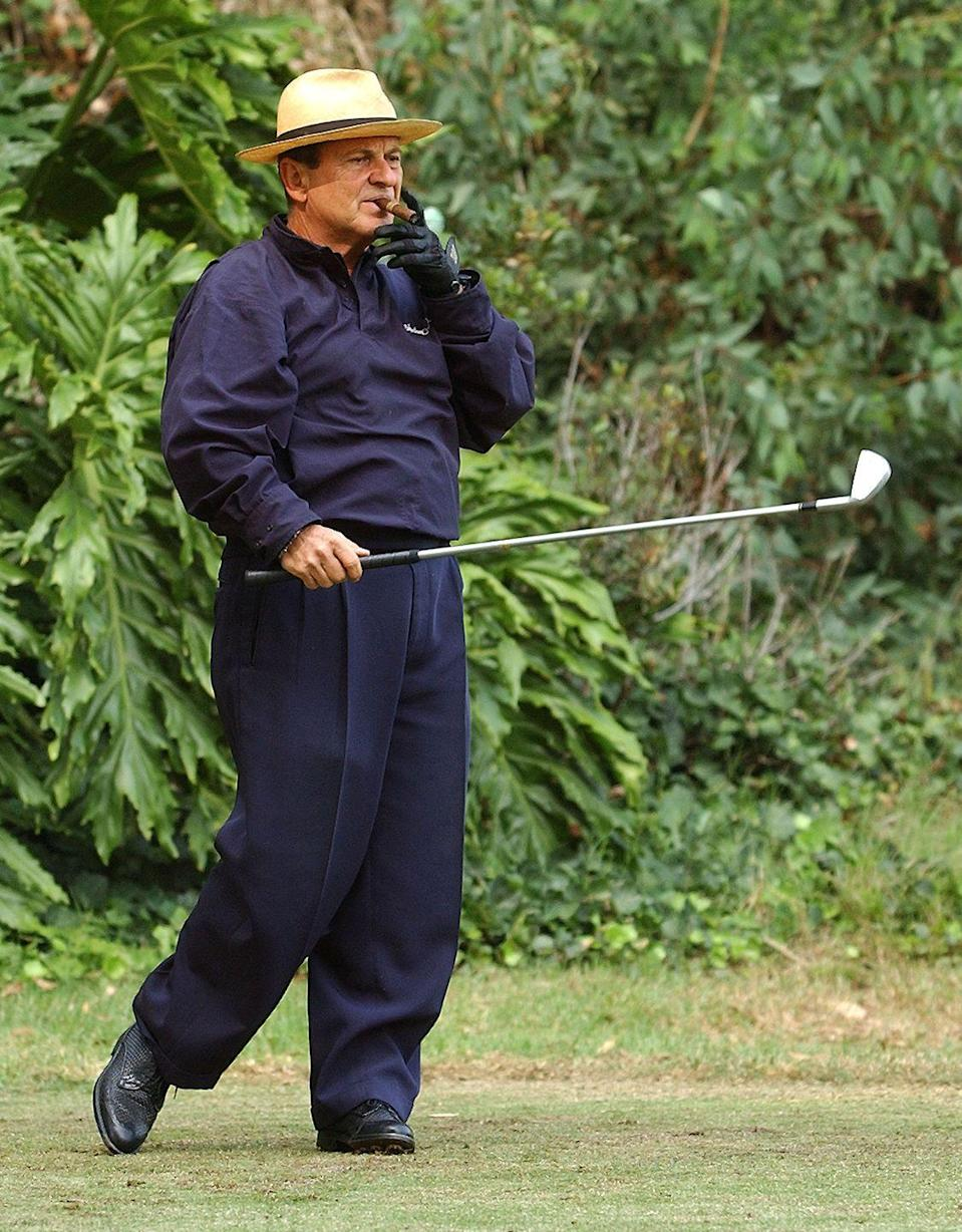 <p>Joe Pesci takes a drag from a cigar before hitting a shot in the 4th Annual Elizabeth Glaser Pediatric AIDS Foundation Celebrity Golf Classic in 2002. </p>
