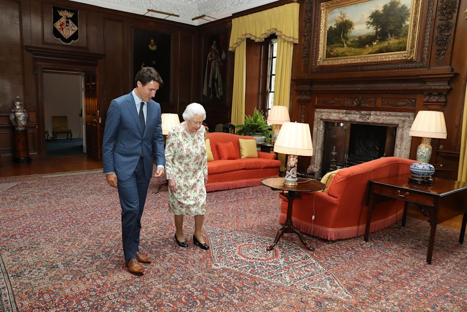 Queen Elizabeth II greets Canadian Prime Minister Justin Trudeau during an audience at the Palace of Holyroodhouse in Edinburgh.