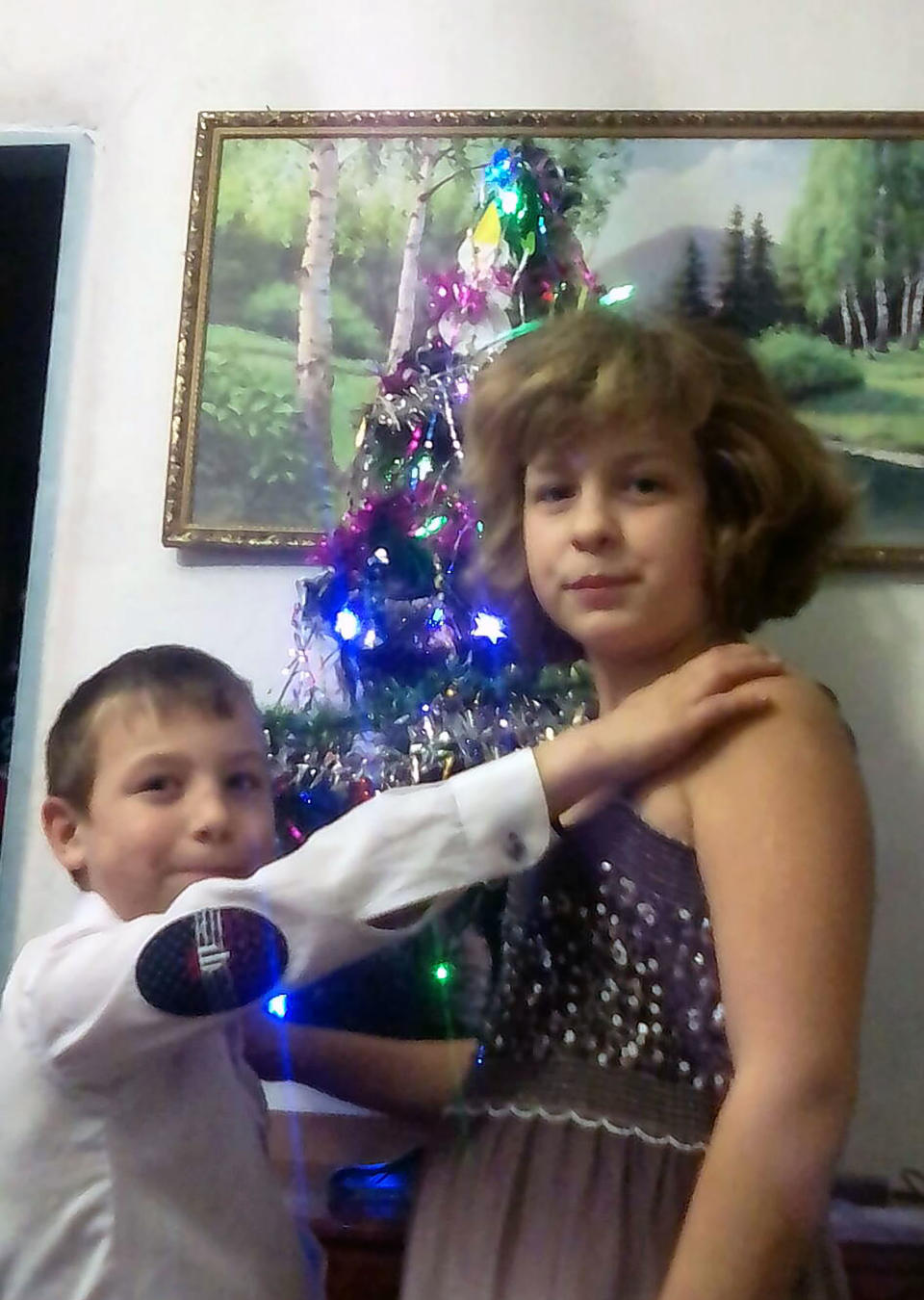 The brother and sister in front of a Christmas tree. Source: East2West/Australscope