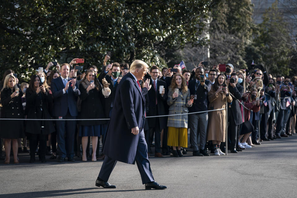 President Donald Trump waves to staff and supporters as he leaves the White House, January 12. Source: Getty