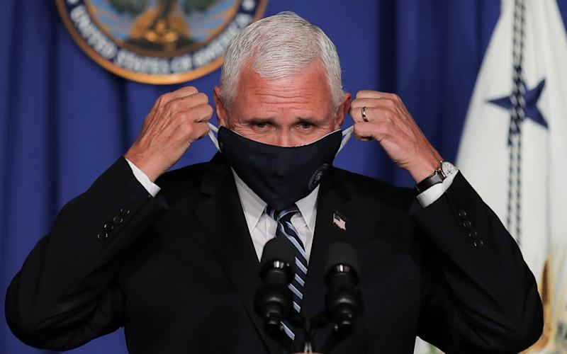 Mike Pence, the US Vice President, set the White House on a collusion course with state governors when he called for schools to reopen in a briefing on Wednesday afternoon - CARLOS BARRIA/REUTERS