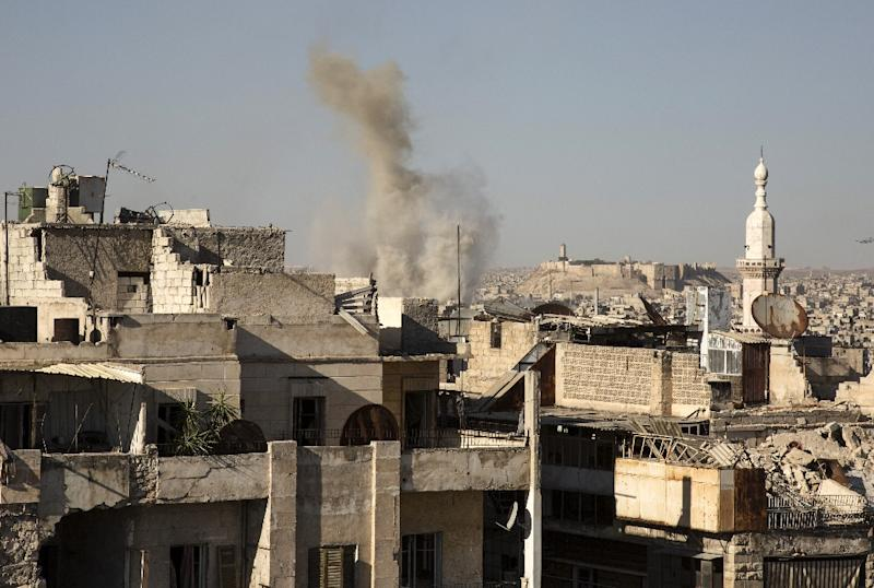Smoke billows following a reported air strike by pro-Syrian government forces in a rebel-held neighbourhood of Aleppo on July 12, 2016