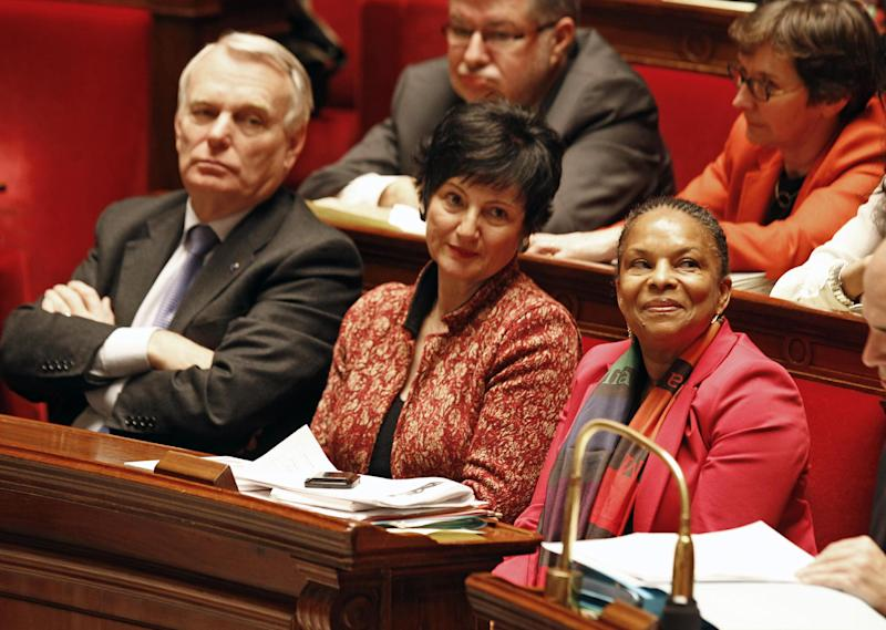 French justice minister Christiane Taubira, right, sits on the government bench with social affairs minister Dominique Bertinotti, center, and prime minister Jean Marc Ayrault, during the vote at the National Assembly in Paris, Tuesday Feb. 12, 2013, of a new law legalizing gay marriage.  France's lower house of parliament has approved a sweeping bill to legalize gay marriage and allow same-sex couples to adopt children. President Francois Hollande's Socialists have pushed the measure through the National Assembly and put France on track to join about a dozen, mostly European nations that grant marriage and adoption rights to homosexuals. (AP Photo/Remy de la Mauviniere)