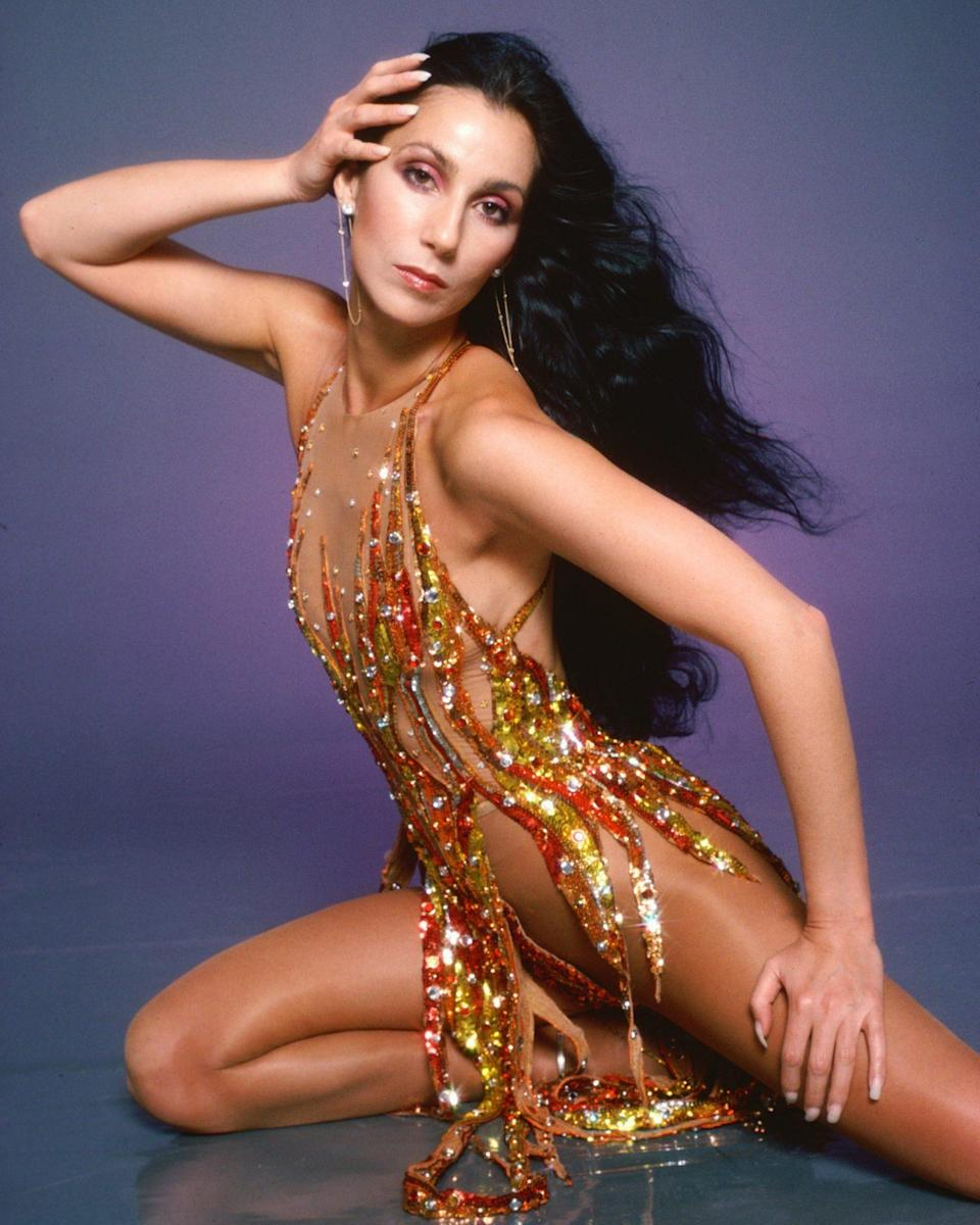"""<p>Cher always """"Dressed to Kill,"""" like when she wore this dress that made her look like the human version of the fire emoji in 1978. </p>"""