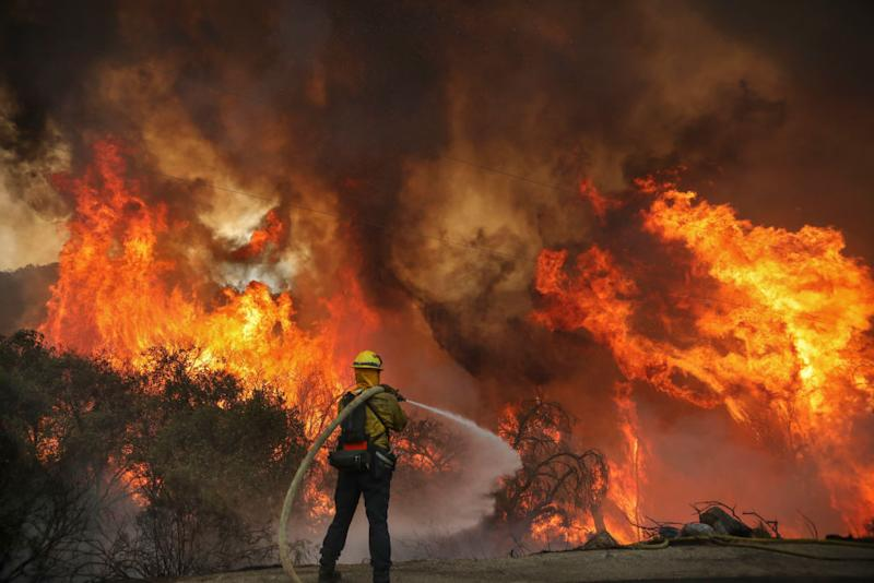 San Miguel County Firefighters battle a brush fire on Sunday. Source: Getty