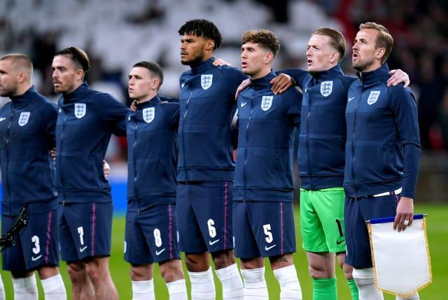 England's Harry Kane (right), goalkeeper Jordan Pickford, John Stones, Tyrone Mings, Phil Foden and Jack Grealish sing the national anthem