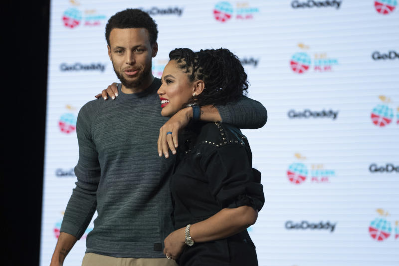 IMAGE DISTRIBUTED FOR GODADDY - Stephen Curry and Ayesha Curry launch the new Eat. Learn. Play. foundation website (www.eatlearnplay.org) powered by GoDaddy at the Midway on Tuesday, Sept. 17, 2019, in San Francisco. (Photo by Don Feria/Invision for GoDaddy/AP Images)