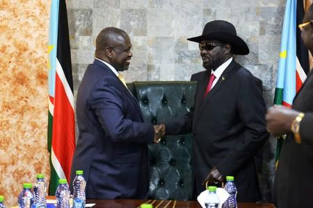 South Sudan's President Salva Kiir Mayardit shakes hands with ex-vice president and former rebel leader Riek Machar during their meeting in Juba