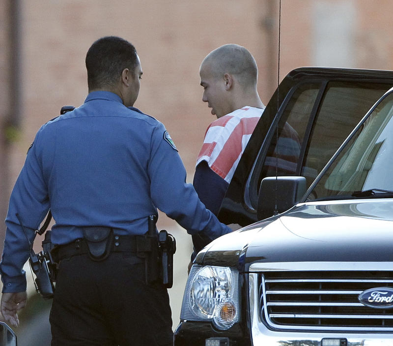 Ryan Edward Doughtery, right, arrives at the courthouse in Walsenburg, Colo., on Tuesday, Sept. 20, 2011, for a preliminary hearing.   Ryan, 21, and his sister Lee Grace Doughtery, 29, and brother Dylan Stanley-Dougherty, 26, are accused in a cross-country crime spree that began in Florida and ended with a police chase and gunplay in Colorado.(AP Photo/Ed Andrieski)