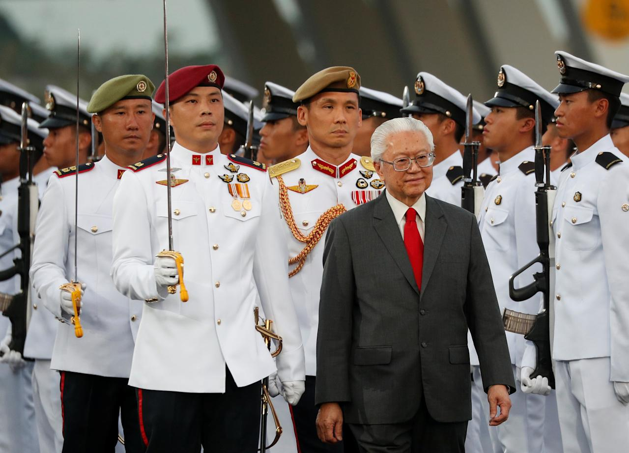 Singapore's President Tony Tan inspects the guard of honour during Singapore's 52nd National Day celebrations at Marina Bay in Singapore August 9, 2017. REUTERS/Edgar Su